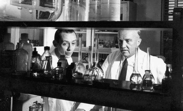 Canadian physiologist Charles Best, right, in the laboratory in 1960 with an assistant