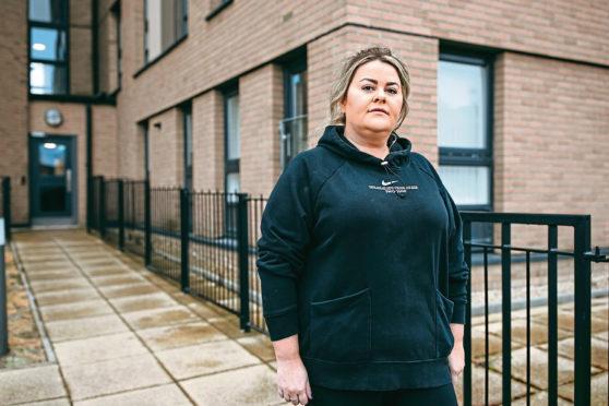Gemma Neil in front of her flat in Glasgow.