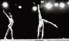 Nadia Comaneci, 13, of Romania, in a double exposure at Wembley's Empire Pool in 1975