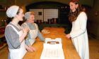 Sophie McShera, as Daisy, and Lesley Nicol, as Mrs Patmore, meeting Kate on Downton set