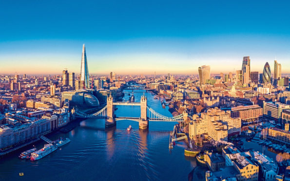 Aerial panoramic cityscape view of London and the River Thames, England.