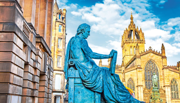 Royal Mile street in Edinburgh, Scotland. Old statue of David Hume.