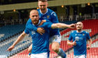Shaun Rooney celebrates