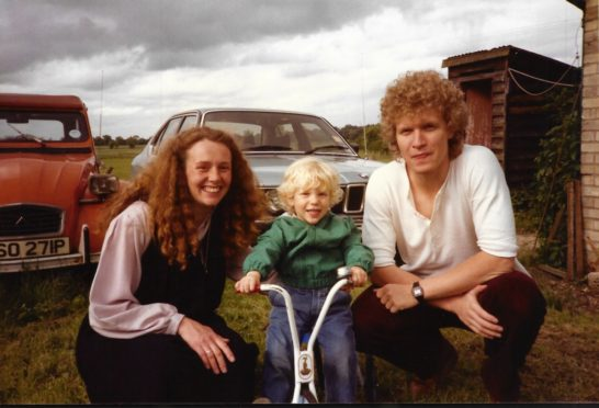 Young Callan Gordon with mum Jax and dad Iain in a treasured family photo