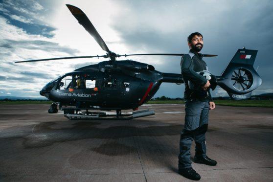 Pilot Ciar Van Holstein on the helipad at Glasgow Airport