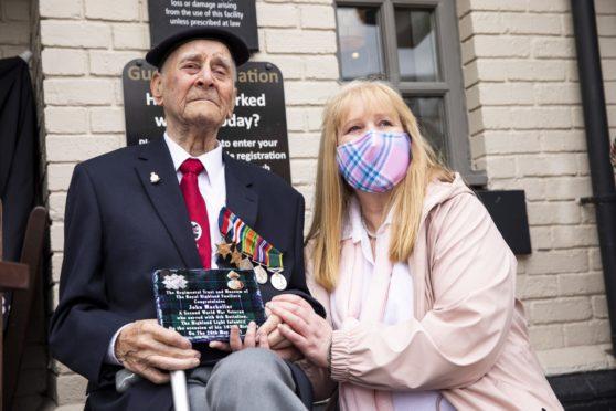 John MacKellar, with niece Linda Murray, watches the parade