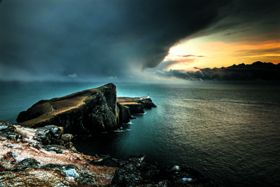 The lighthouse and foghorn at Neist Point on the Isle of Skye look out into the lonely Atlantic Ocean