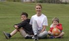 Lisa Kitching with her two sons Joseph and Leo