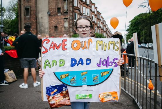 Tyra Hanratty, age 11, whose mum Sharon works at the factory, outside McVitie's in Tollcross, Glasgow
