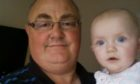 Neil Alexander with baby granddaughter Natalia before he contracted Covid
