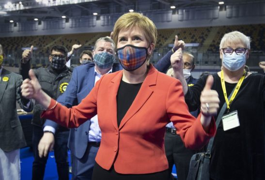 First Minister and SNP party leader Nicola Sturgeon celebrates after retaining her seat for Glasgow Southside