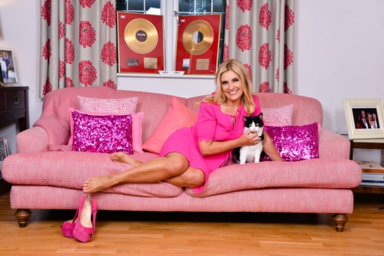 Vocal coach Yvie Burnett keeps her trademark heels close at hand while she relaxes at home with cat Rimple