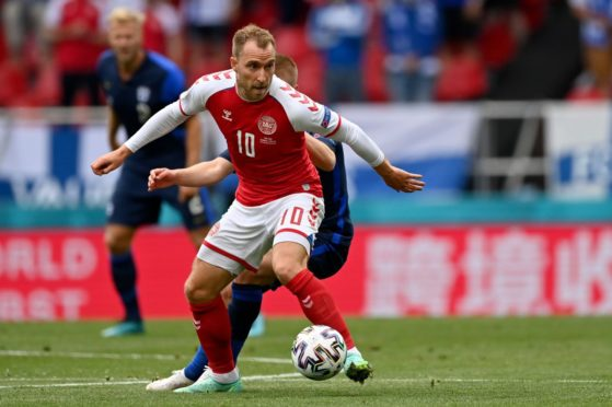 Christian Eriksen in action during the first half of the game