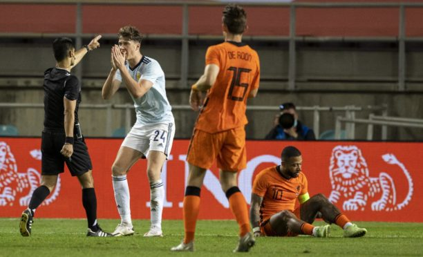 Scotland's Jack Hendry protests referee Vitor Ferreira as The Netherlands are awarded a freekick late on during a friendly match between Scotland and Netherlands at Estadio Algarve, on June 02, 2021.