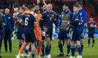 Kieran Tierney and David Marshall embrace at full-time as Scotland's players                       enjoy the moment after drawing at Wembley.