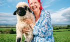 Gia the lamb, with owner Ali Thom, at Arnbeg Farm, Stirlingshire. Gia was born with bad legs, and Ali used an Ikea bag, to help carry and reabilitate her - she is now doing much better and running about in the field with the other sheep.