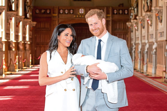 The then Duke and Duchess of Sussex with their baby son Archie Harrison Mountbatten-Windsor.