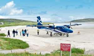 Passengers board a Loganair flight at Traigh Mhor beach, Barra in the Outer Hebrides