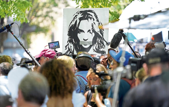 Portrait of Britney Spears looms over supporters and media members outside a court hearing concerning the pop singer's conservatorship at the Stanley Mosk Courthouse, in Los Angeles.