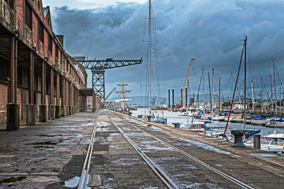 James Watt Dock in Greenock looking along the old railway lines with its old derelict warehouses that used to house the brown sugar molasses.