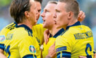 Three of Sweden's 'Foreign Legion' – (from left) Kristoffer Olsson of Krasnodar, RB Leipzig's Emil Forsberg and Ludwig Augustisson of Werder Bremen – celebrate their opening goal against Poland on their way to winning Group E at the Euros.