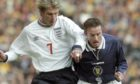 Kevin Gallacher tussles with David Beckham at the Euro 2000 Play-off at Hampden in 1999