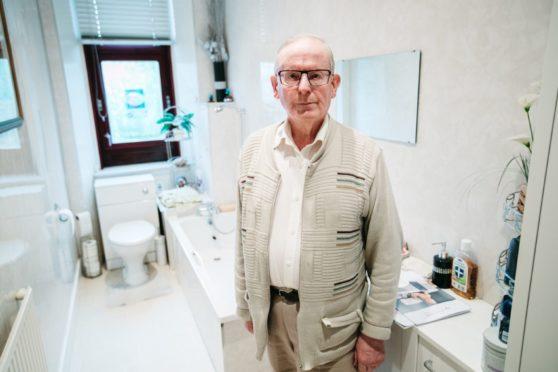 Sepsis survivor William Webster in his bathroom