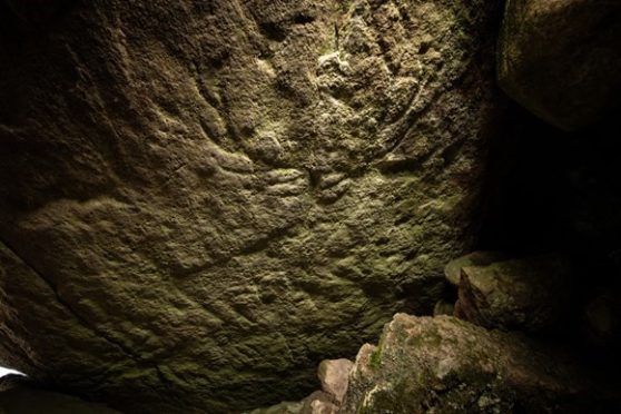 Prehistoric carvings found at the site.