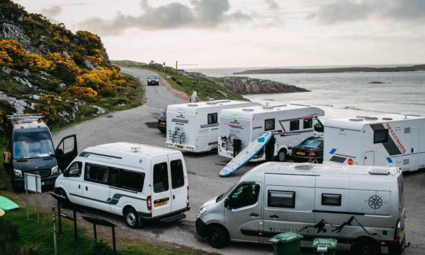 Campervans parked up at Ceannabeinne Beach, near Durness
