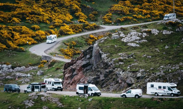 Campervans on the road near Durness.