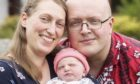Parents Margaret Paluszynska and Richard Winfield with baby Isabella at home in Archiestown, Morayshire
