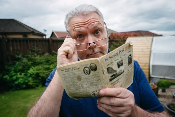 Stephen Lees, with a special limited edition miniature Sunday Post newspaper from 1933, which he found in his late father's belongings