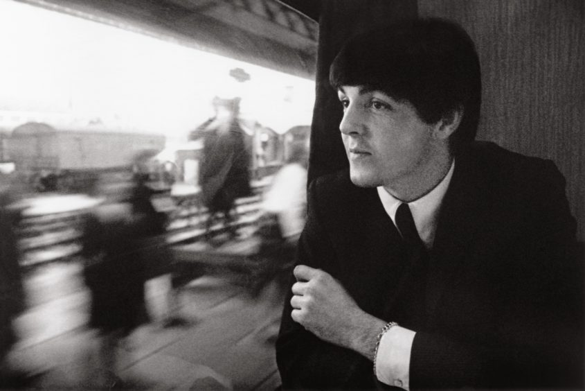 """London, 1964 Sitting quietly on a train leaving Paddington Station during filming of A Hard Day's Night: """"This is Paul trying to remember his lines for the train scene in the film. It was chaotic with all the film cameras on the train, but I think Paul and John enjoyed making the movie. They were asked to do the same things over and over again for the cameras, but never lost their temper or displayed any attitude about it."""""""