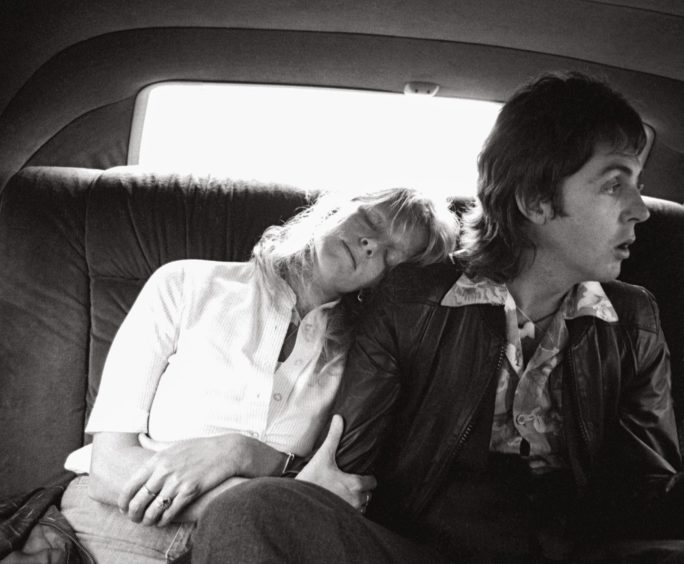 """New York, 1976 Giving wife Linda McCartney a shoulder to lean on the way to LaGuardia airport on May 26 1976 after two nights playing at Madison Square Garden on the Wings over the World tour: """"It was a tough, tiring time for them. Every day it was another dressing room, another car, another airport, another security gate. I was tired too, but that's when the likes of us need to find the extra energy to get the photographs that no one else has. This was my opportunity to get something fresh, something that people hadn't seen before."""""""