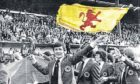 Bruce Rioch flies the flag as Ally MacLeod's squad wave goodbye to 30,000 fans at Hampden stadium in Glasgow as they head off to the 1978 World Cup in Argentina with high hopes