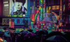 """Wong on his photograph Neon Noir: """"A sea of umbrellas passing through Shibuya Crossing in the rain at night, top left. My favourite time to capture the streets is during heavy rain, as people are always in a hurry to be somewhere."""""""