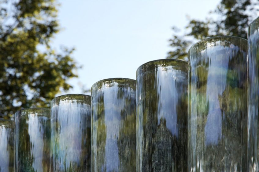 Cylinders of pure cast glass collected from deserts across the Earth
