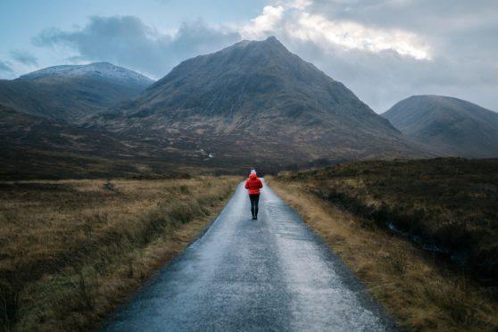 A lone hiker explores Glen Etive