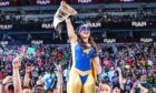 Scots WWE star Nikki A.S.H. with the Raw women's title