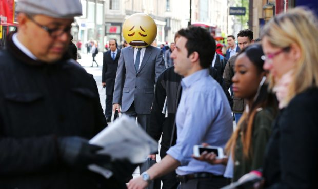 Sad-face emoji man tours London as TalkTalk launches low-price mobile SIM in 2015