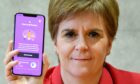 First Minister Nicola Sturgeon views the Covid-19 track and trace app