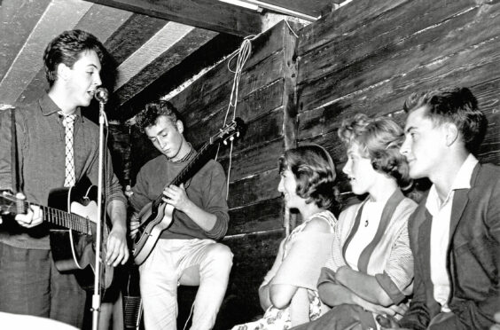 The Quarrymen featuring John Lennon and Paul McCartney perform onstage at their first concert at the Casbah Coffee House – the drummer Pete Best's basement – with Lennon's future wife Cynthia, right, on August 29, 1959 in Liverpool