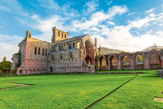 The ruins of Melrose Abbey originally founded in 1136
