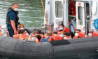 A Border Force vessel brings in migrants found off the coast of Dover in Dover, Kent.