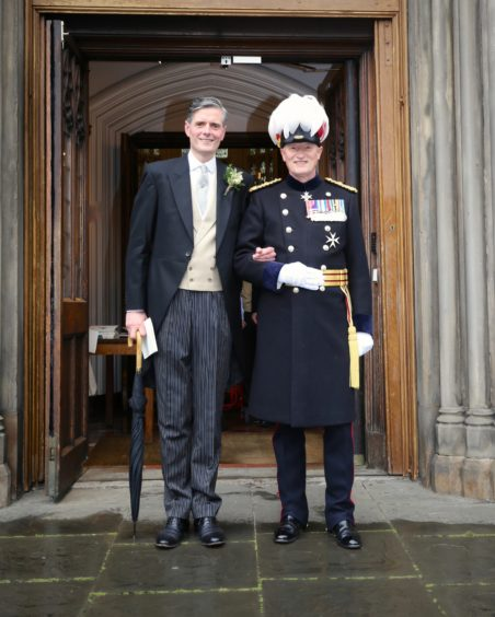 Major General Alistair Bruce with partner Stephen Knott on their wedding day