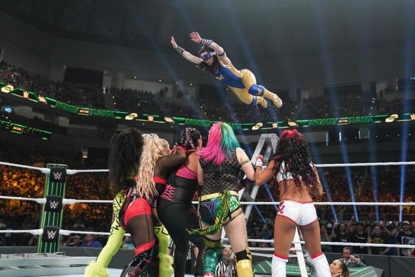 Nikki flies from the top of the ladder during the Money In The Bank pay-per-view