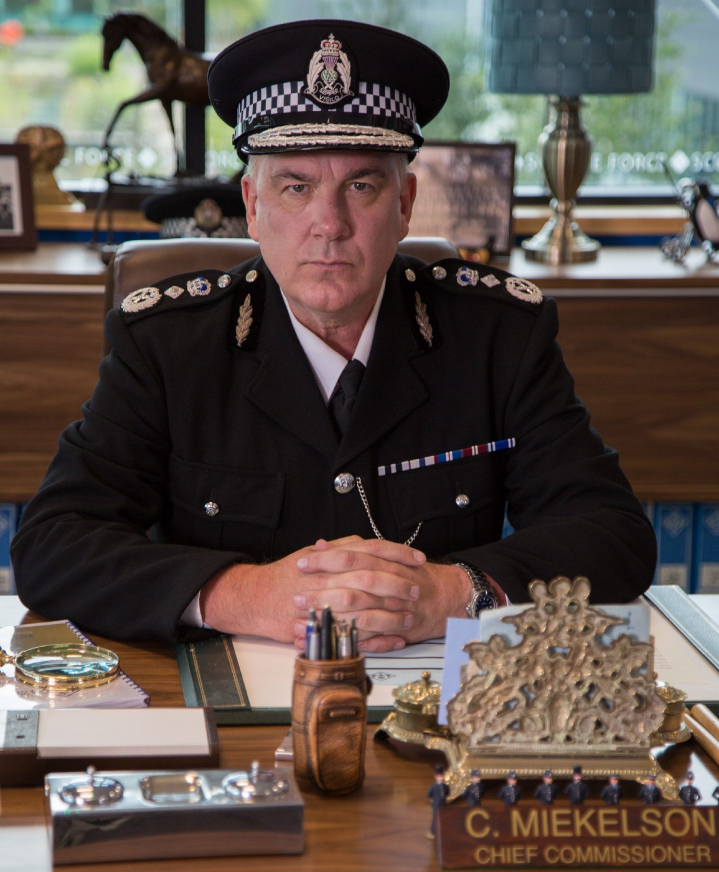 Jack Docherty as Scot Squad chief Cameron Miekelson