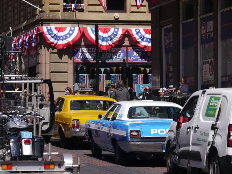 Vintage American vehicles on set