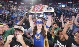 Nikki A.S.H. celebrates with the crowd at a packed arena in Texas after winning the belt