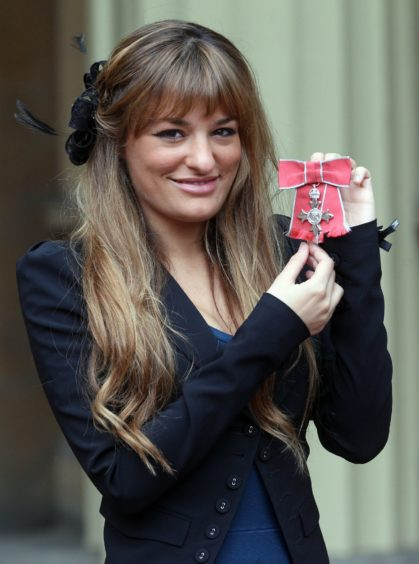 Nicola being made an MBE in 2013